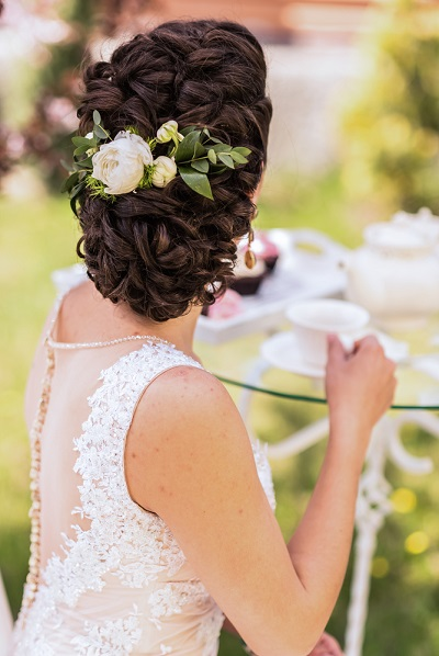 wedding bride hairstyle with a live flower